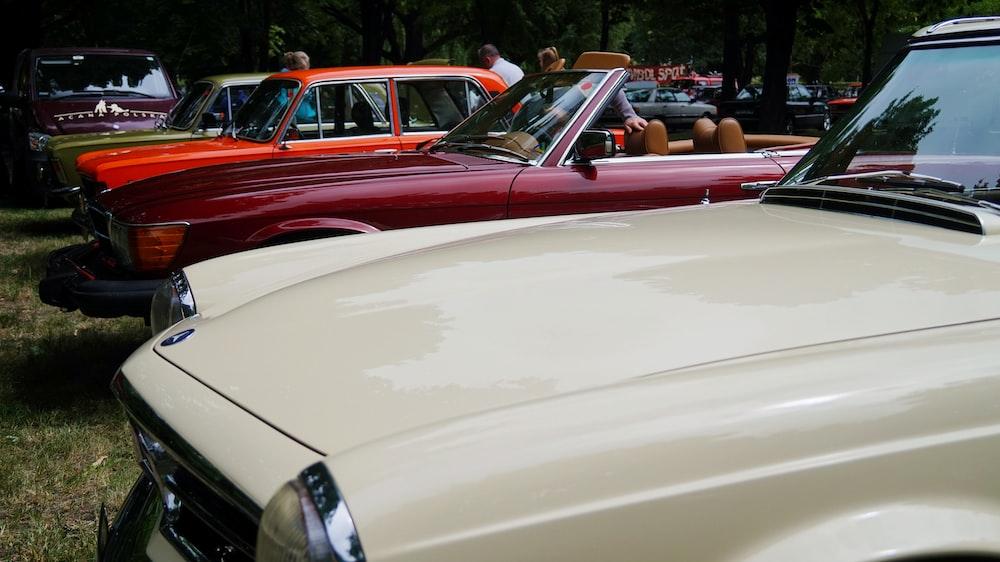 white car beside red car