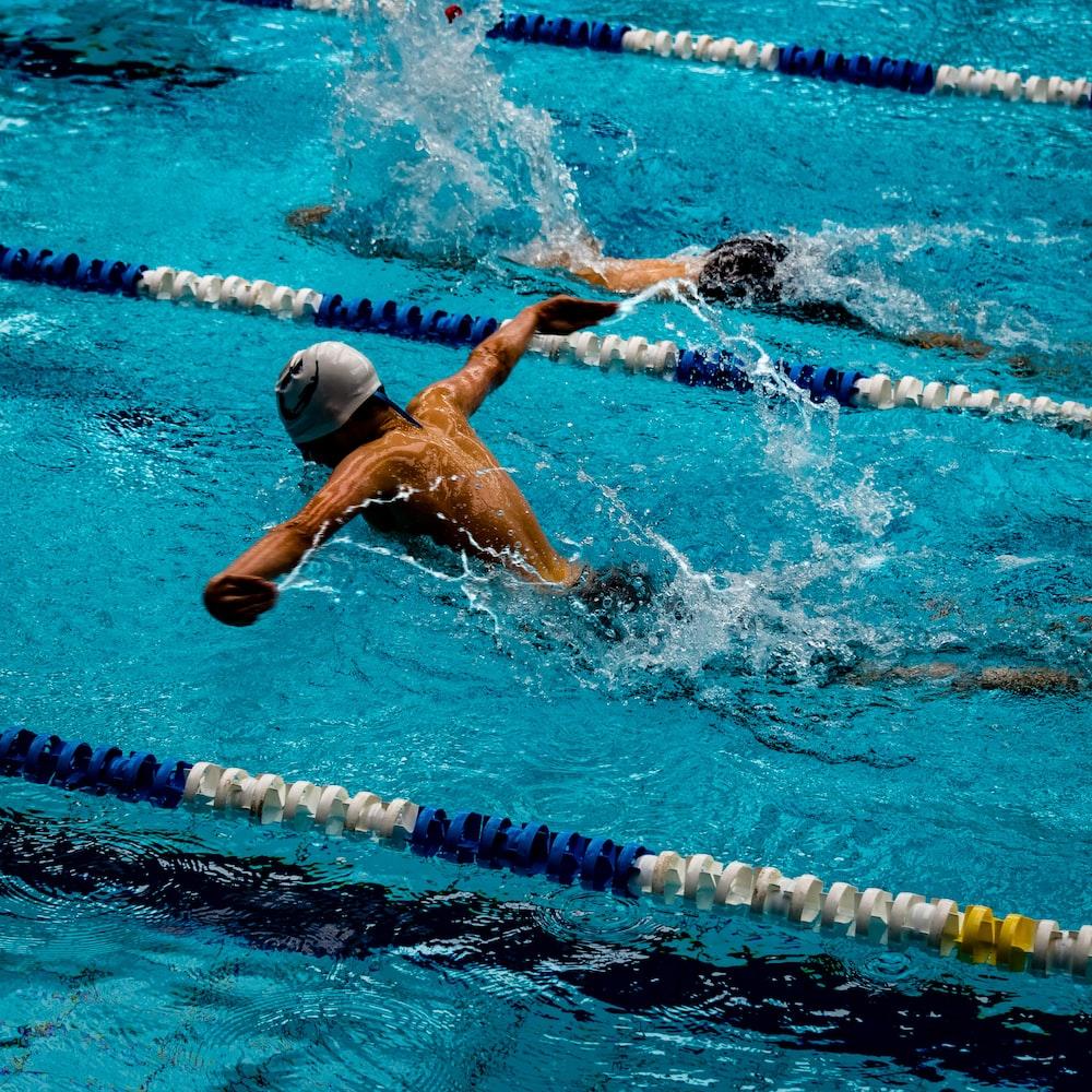 person swimming on marathon