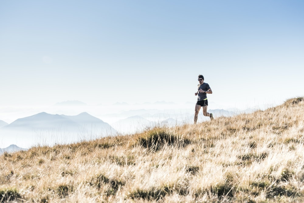 man running on the mountain
