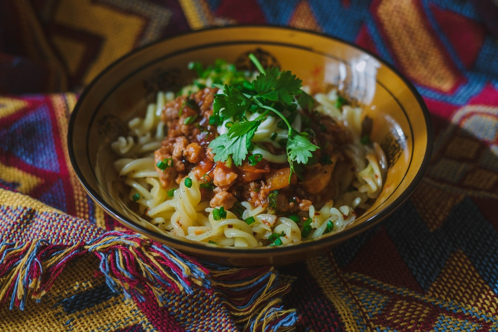 noodles with red sauce and parsley