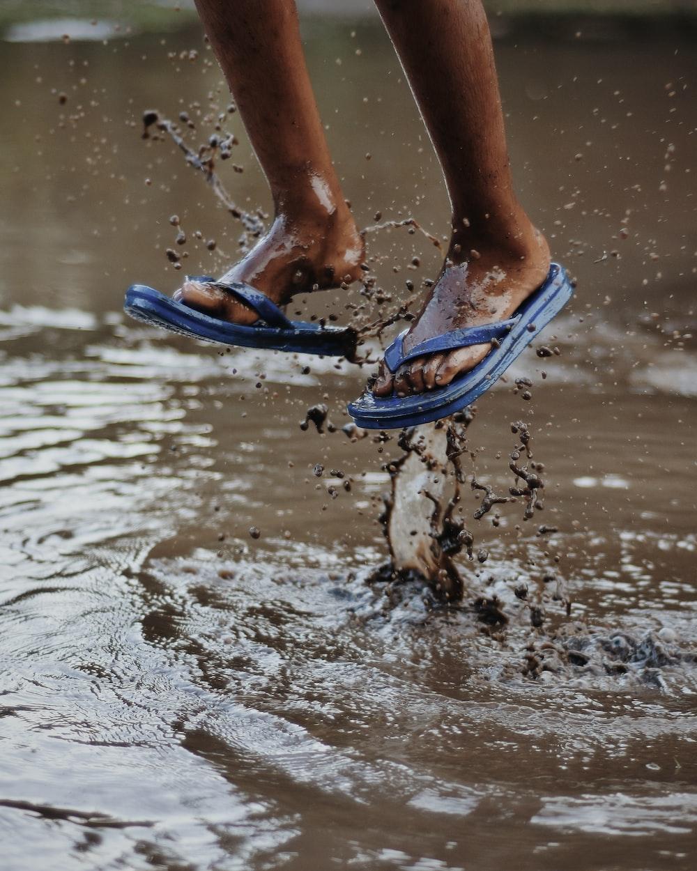 person wearing blue flip-flops