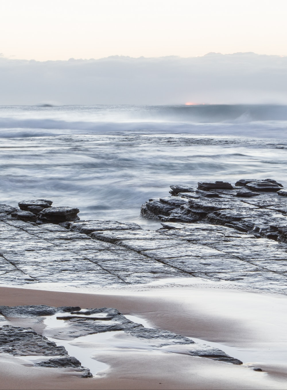 ocean waves hitting the rocky coastline