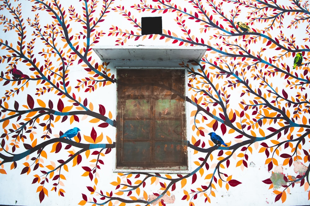 multicolored bird on trees painting