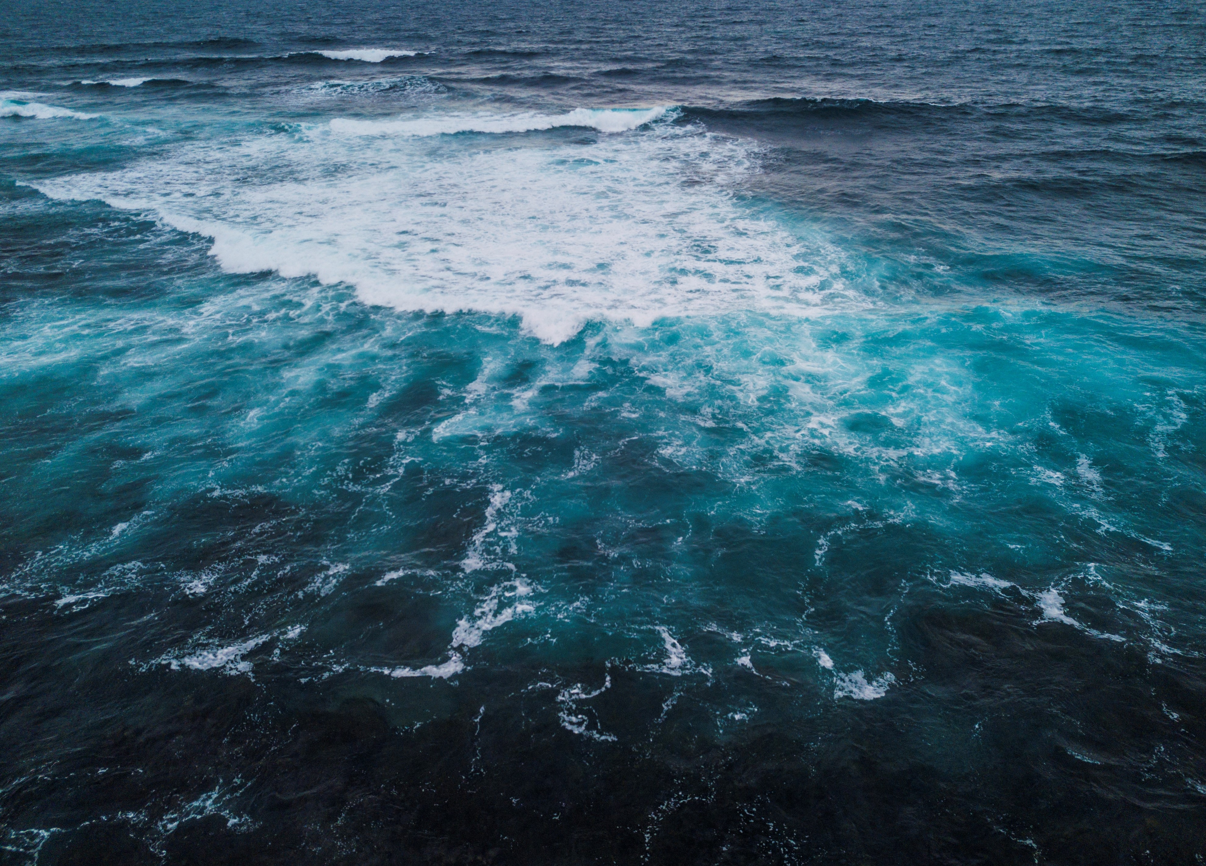 green and blue ocean waves
