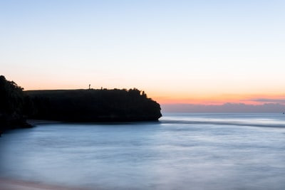 landscape photography of cliff near body of water