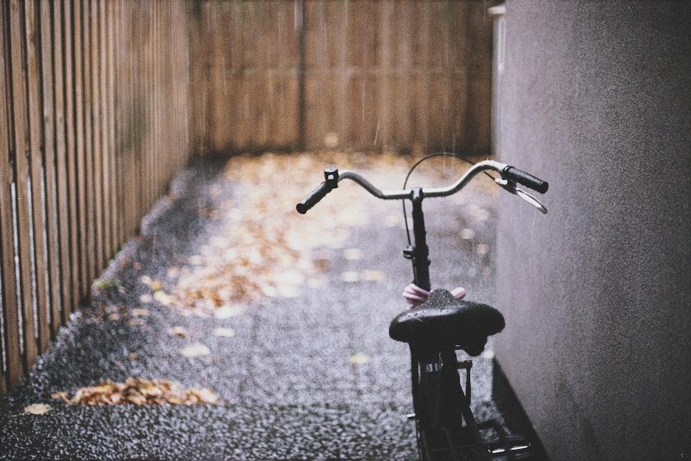 black bike parked near wall