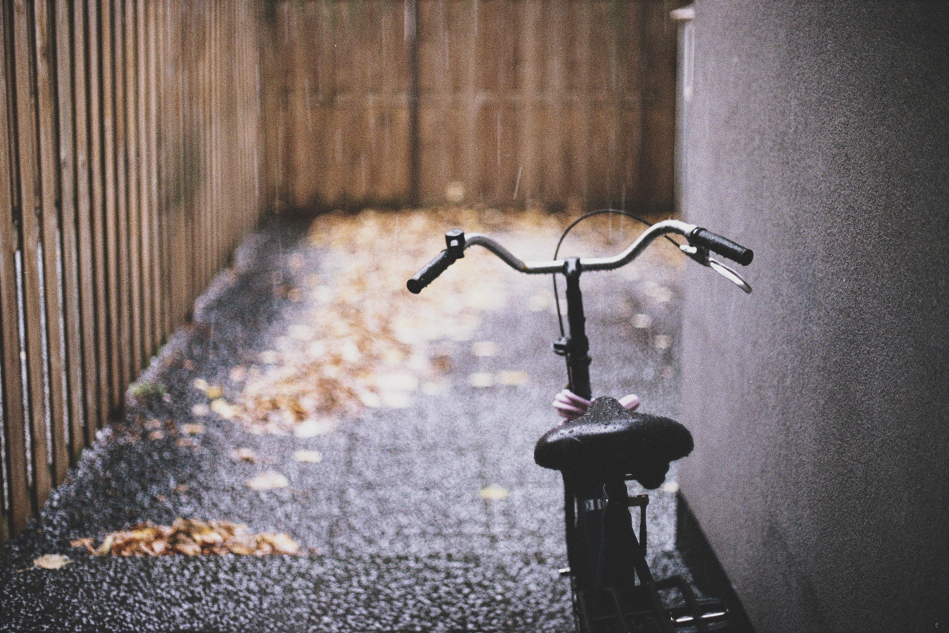 black bike parked near wall