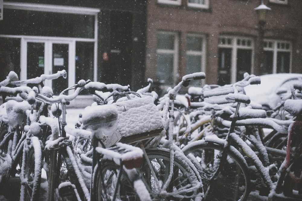 bike parked on street covered with snow