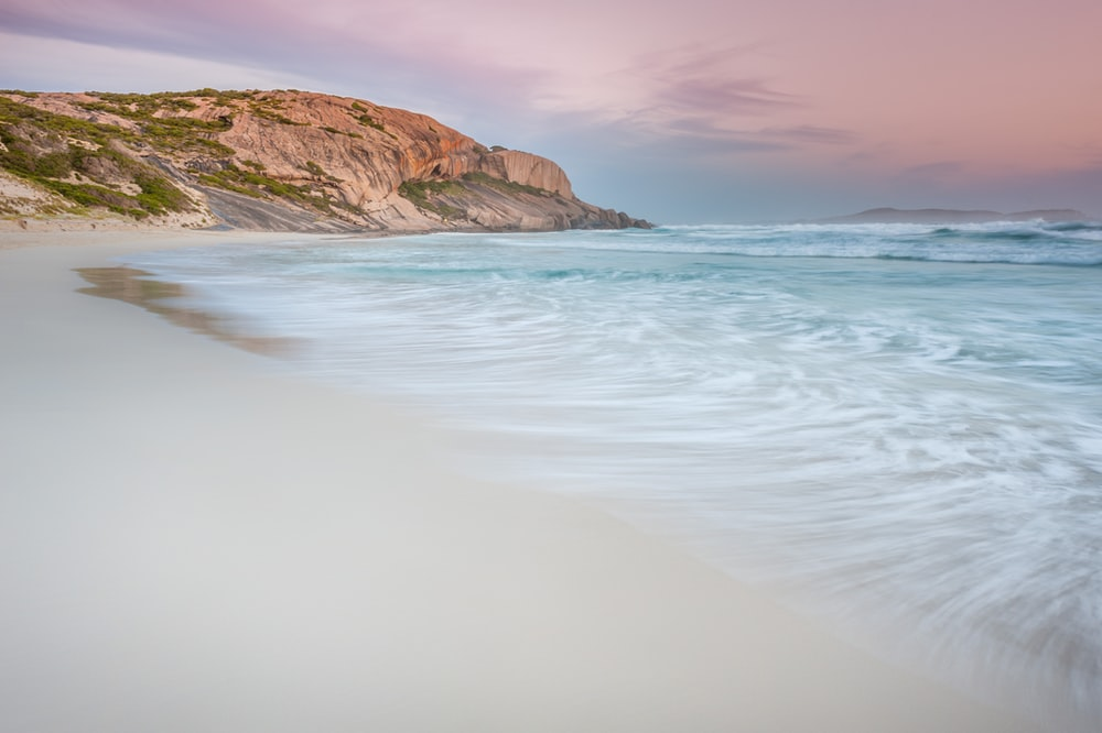 time lapse photography of beach during daytime
