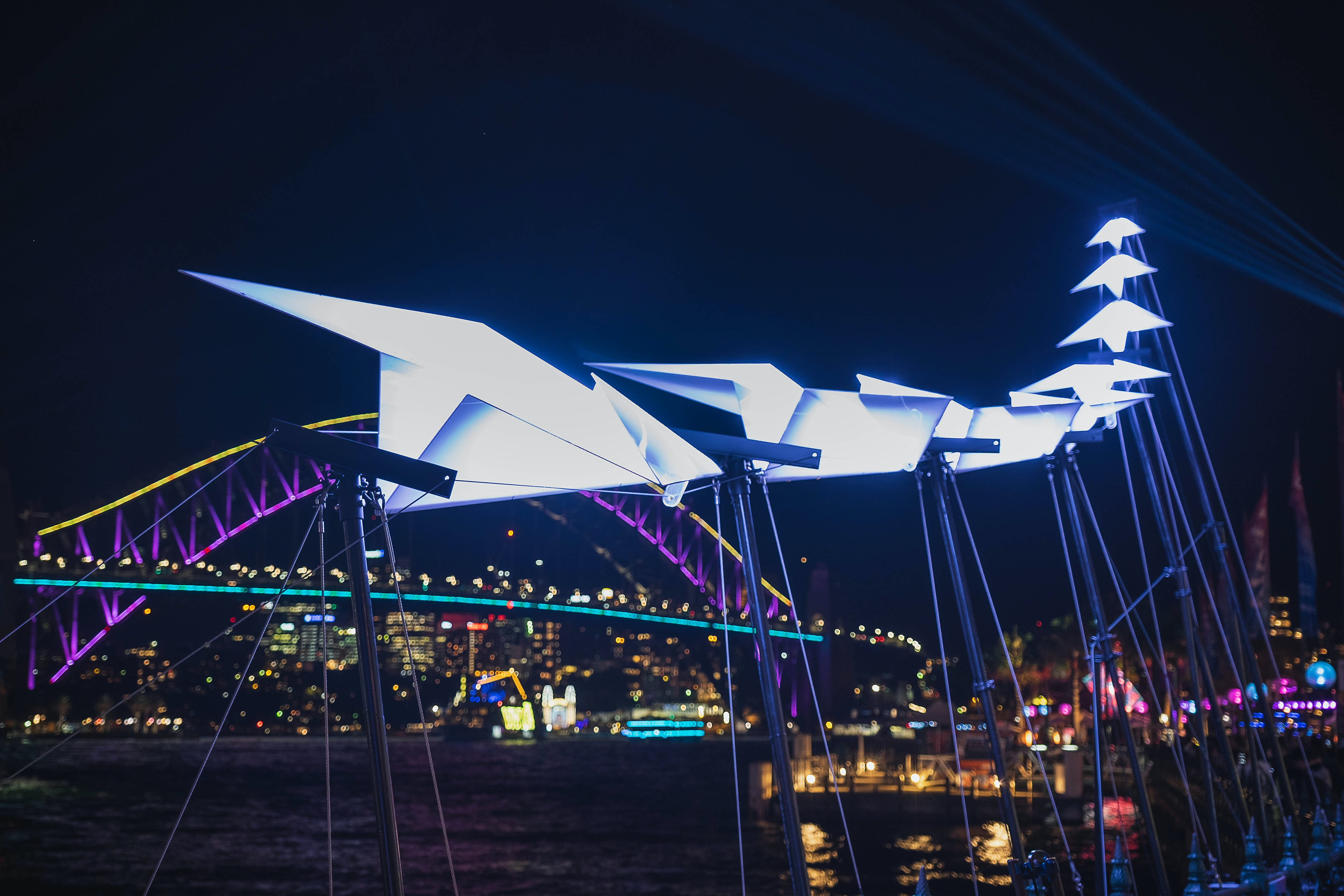 white planes sculpture with lights at night