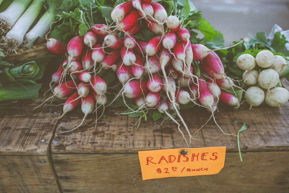 radishes on brown wooden box