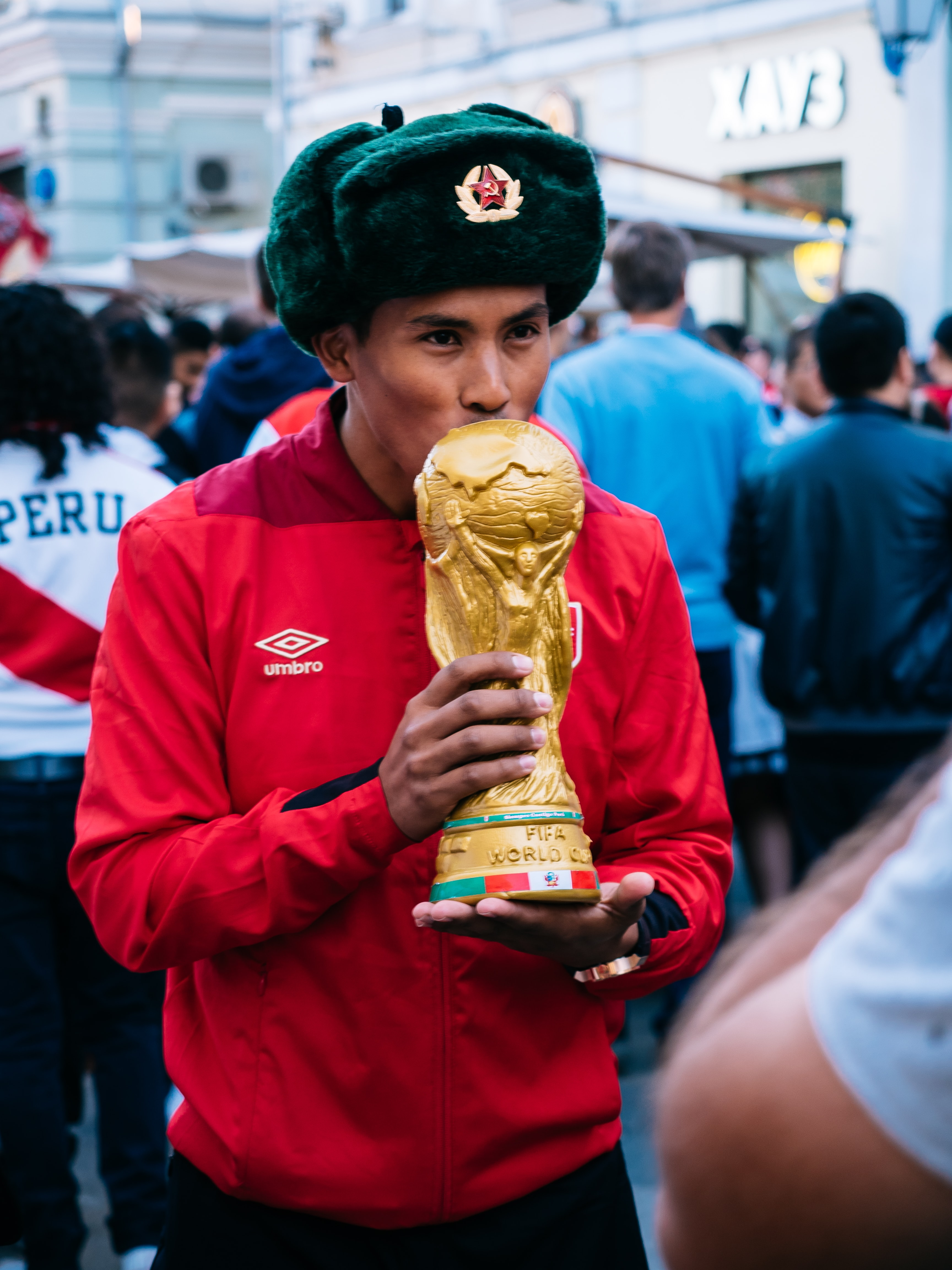 man holding FIFA World Cup trophy