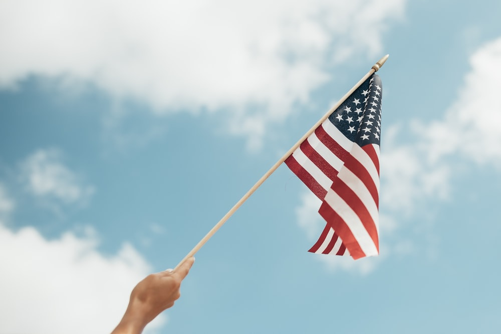 person holding U.S.A. flag