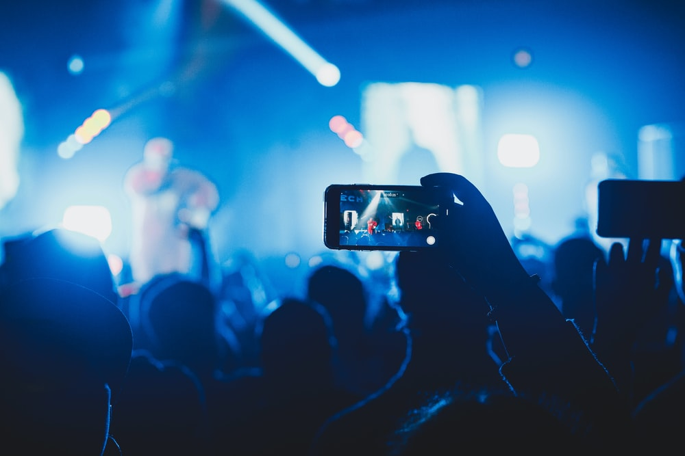 person taking picture on stage