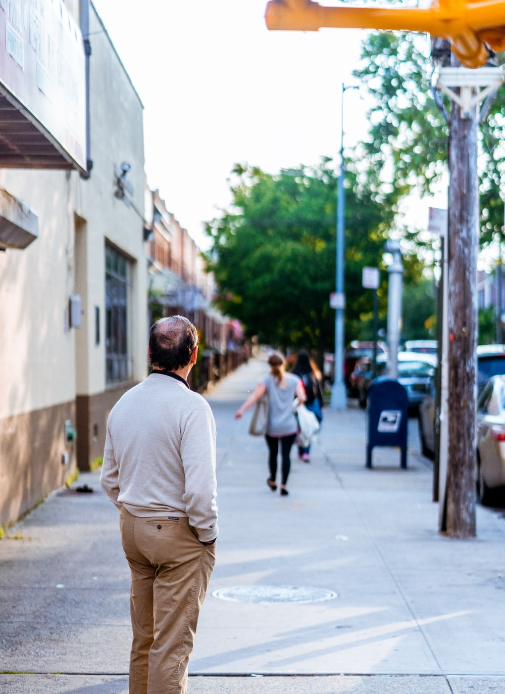 man standing outside looking forward