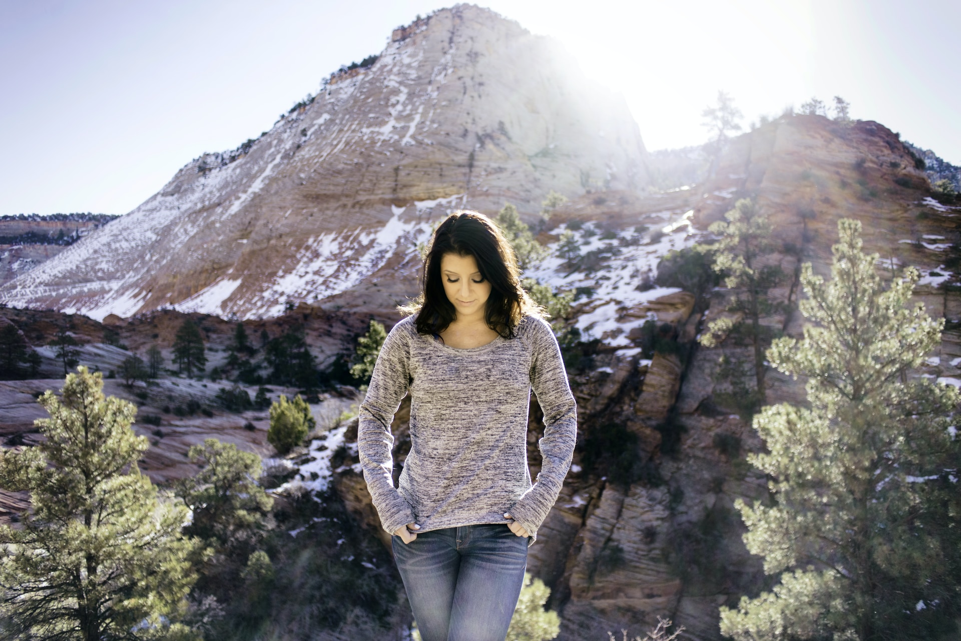 woman standing near tree and alp mountain