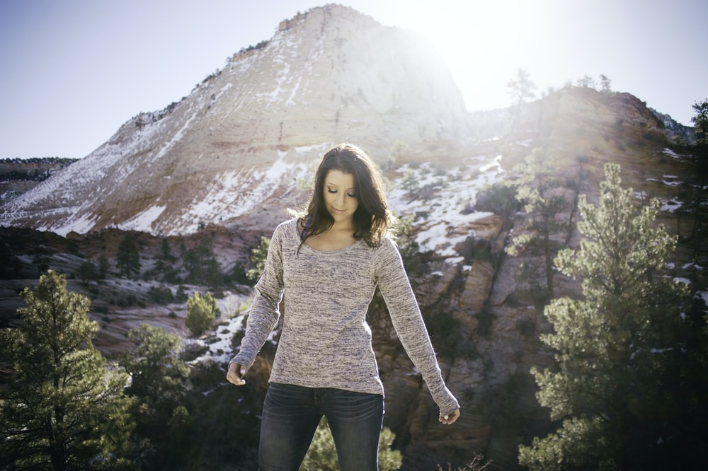 woman standing on front of mountain