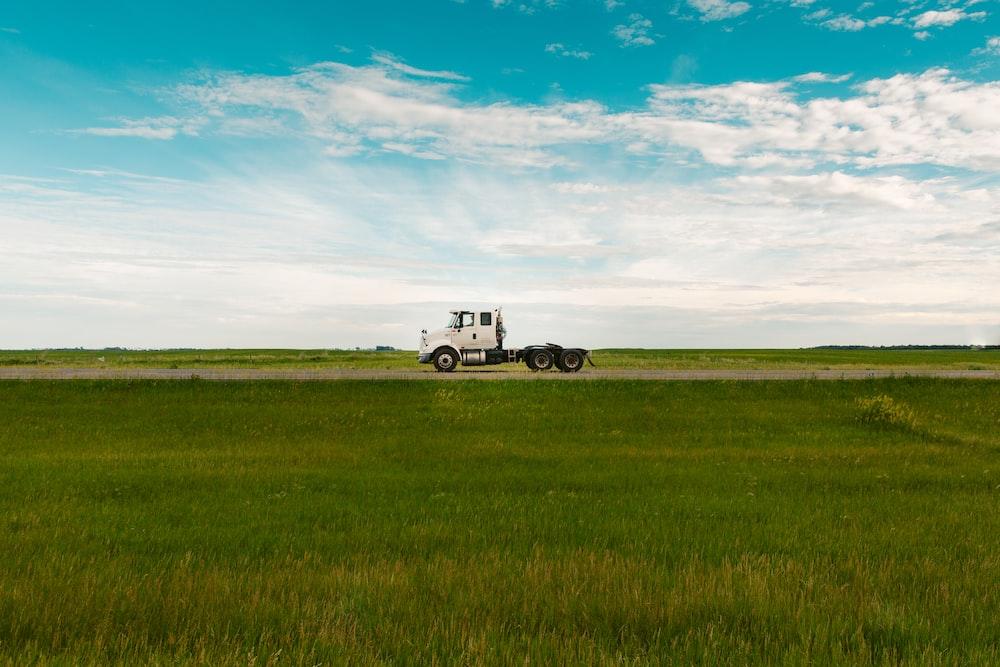 white freight truck on farm