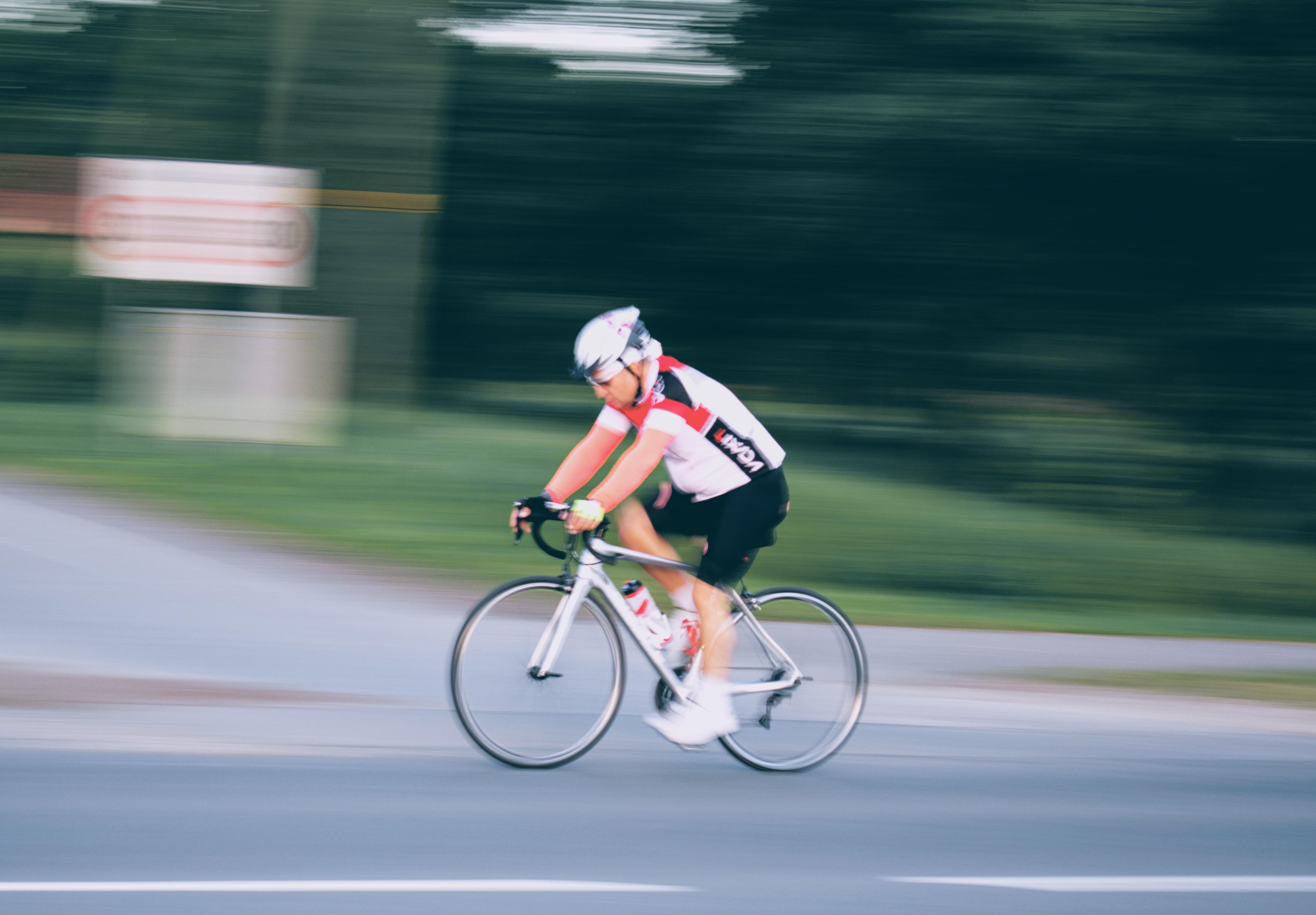 time-lapse photo of man biking
