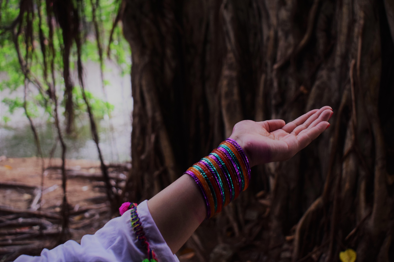 woman raising her hand upward opening her palm