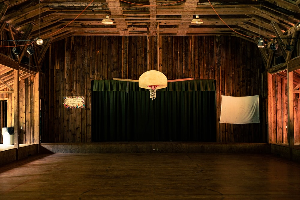indoor photography of basketball court