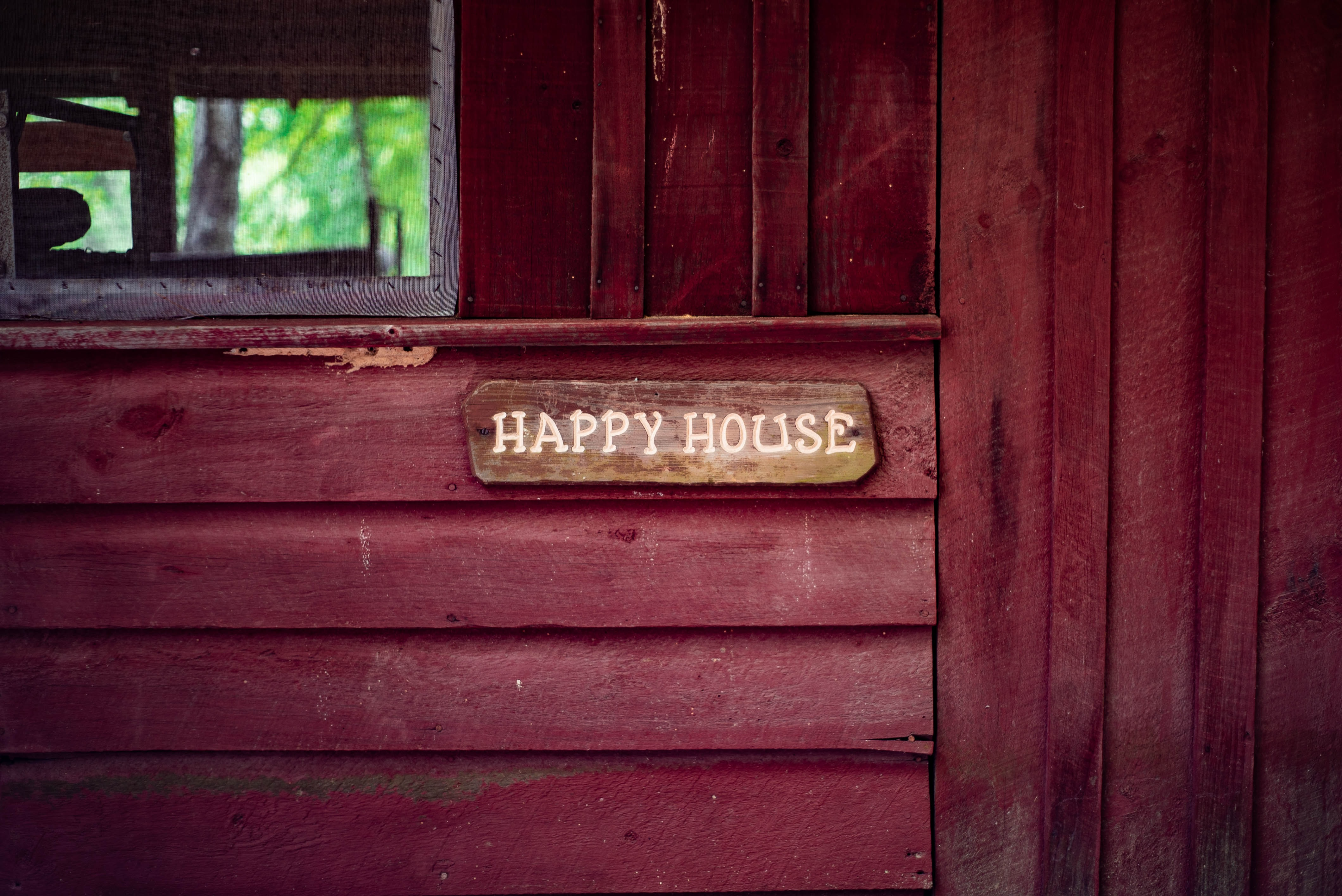 Happy House wooden signage