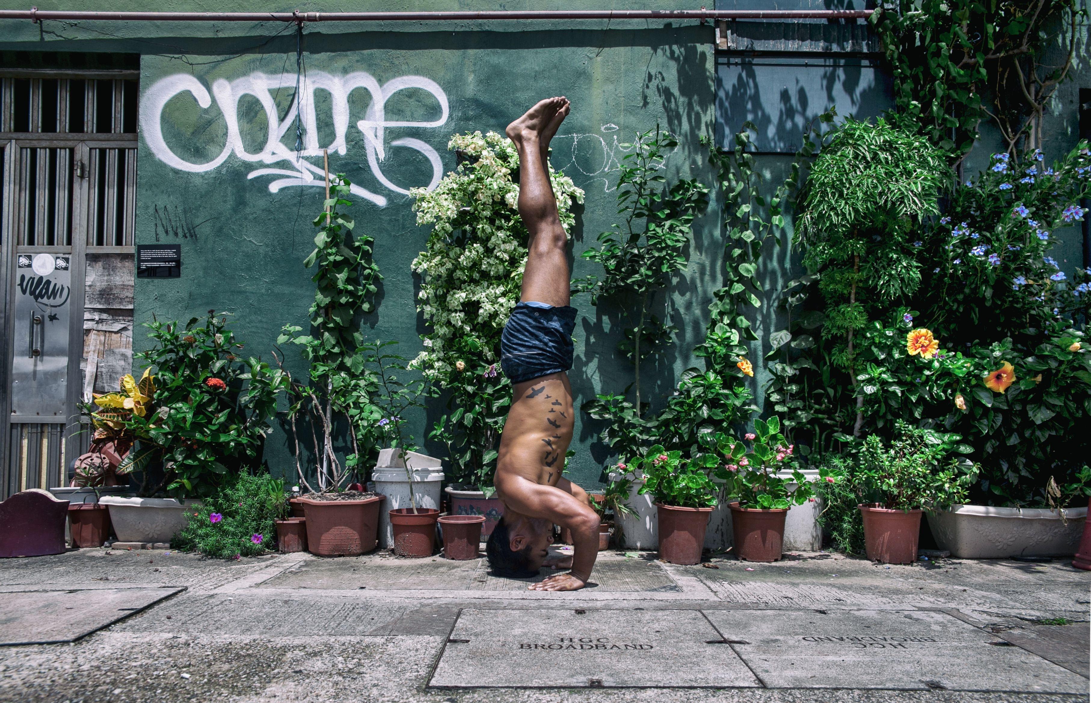 man doing upside down exercise