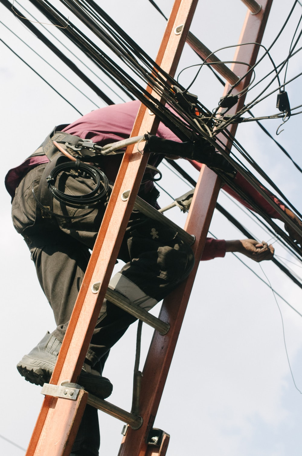 man on top of electrical wires