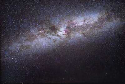 This image shows part of the Milky Way viewed from Tofino in British Columbia. Total exposure of 210 seconds with image stacking and dark frames. The Andromeda galaxy can just be seen on the lower left edge. The bright star in the upper centre is Deneb, in the Cygnus constellation. Just below it you can see the red glow of the North American and the Pelican nebulas. To Deneb's right the Inchworm Cluster is visible. The bright star well over to Deneb's left is the Garnet Star and next to it the Elephant's Trunk nebula can be seen.