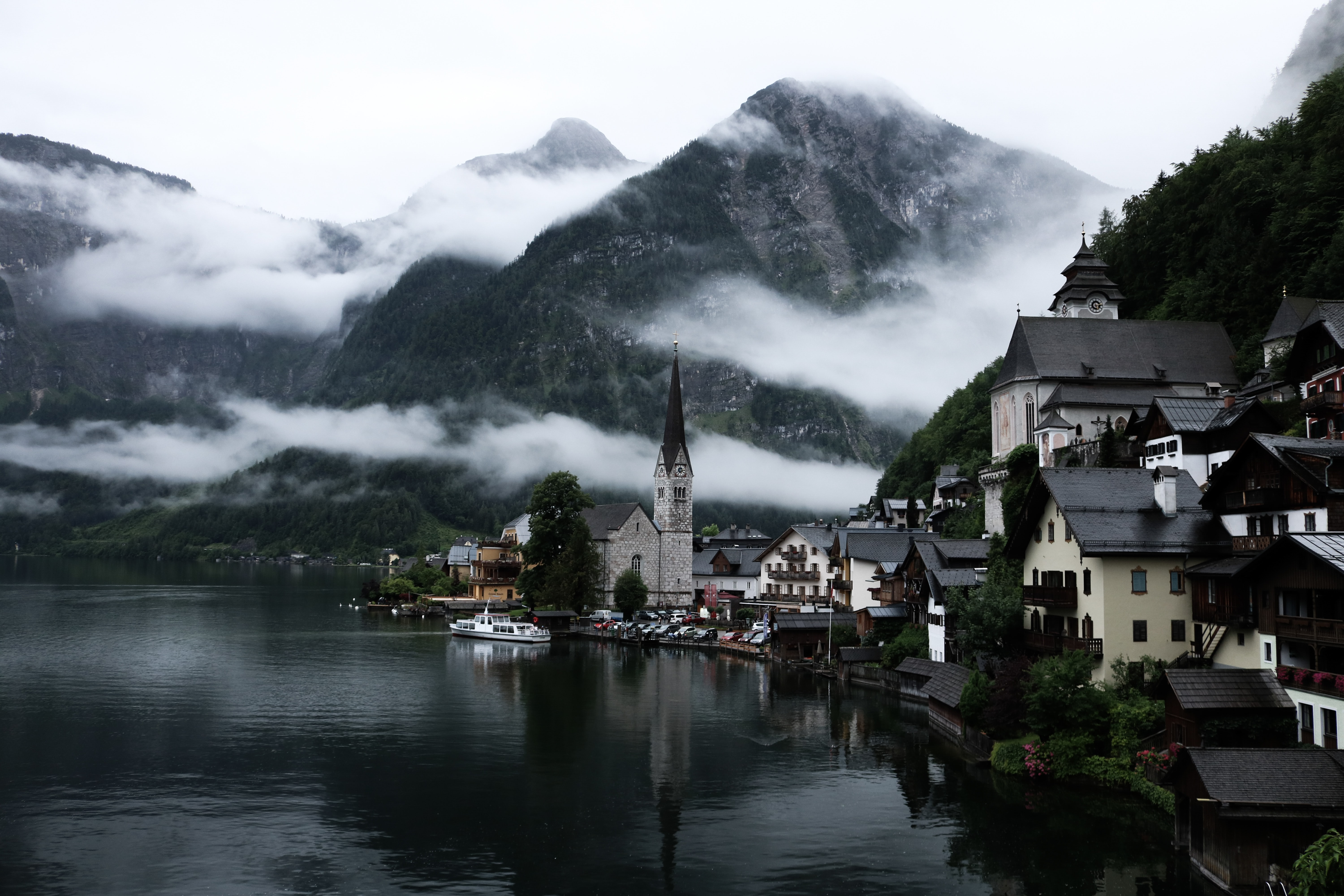 village near lake surrounded by fogs