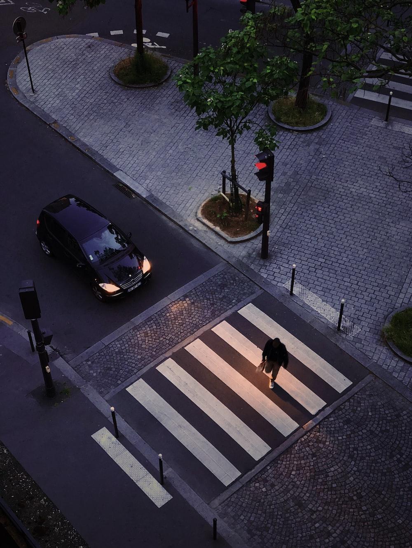 person crossing the pedestrian lane