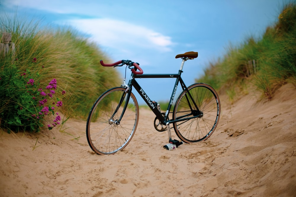 black Pearson road bike on brown sand