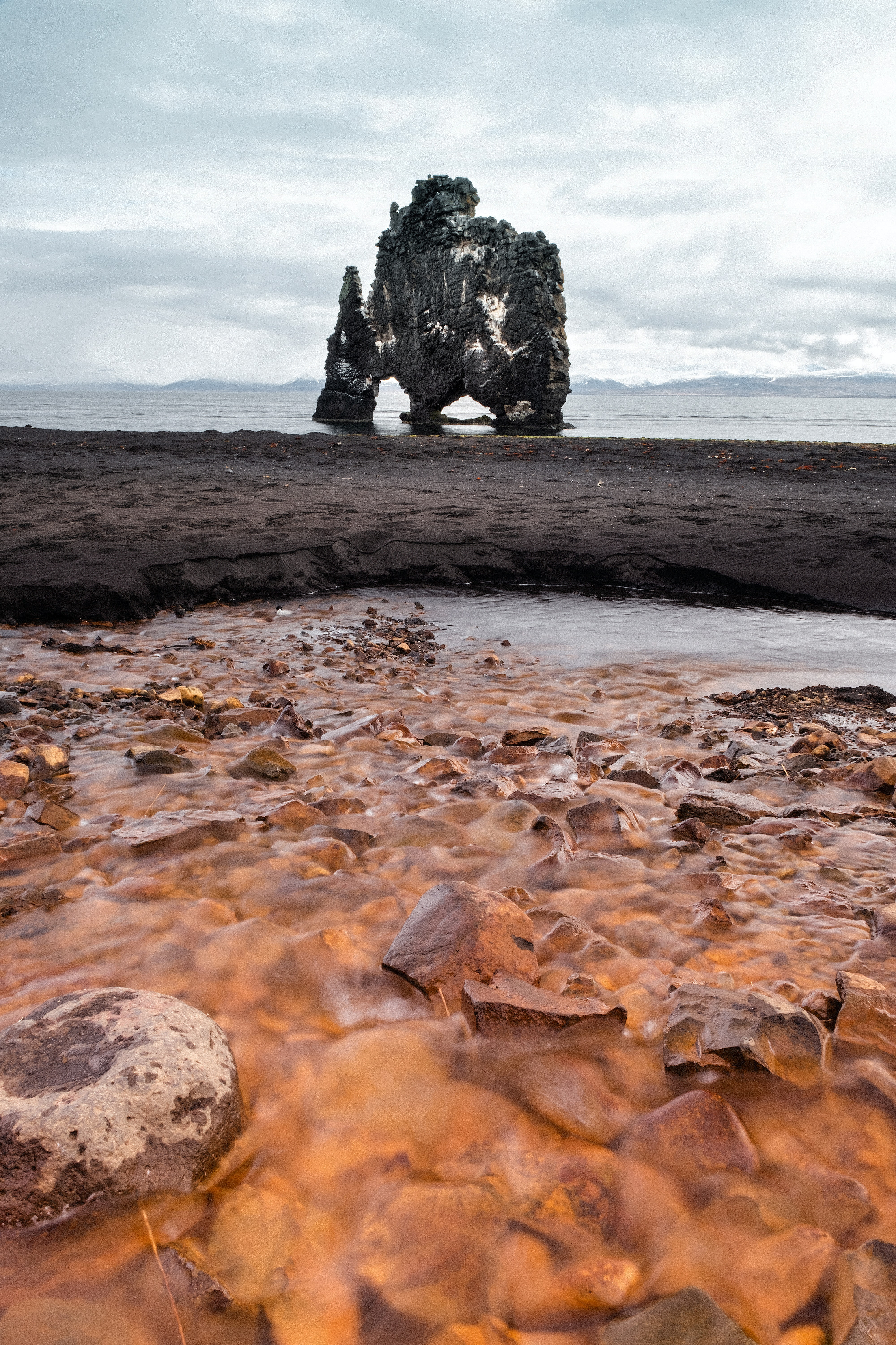 rock formation in body of water