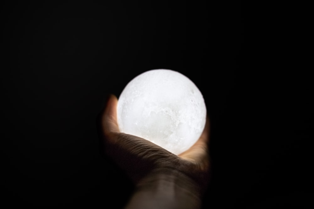 person holding ball lamp