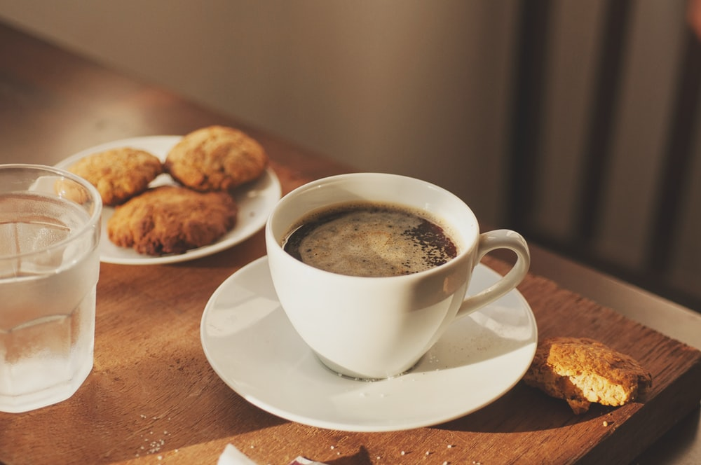cup of coffee and three cookies on saucer