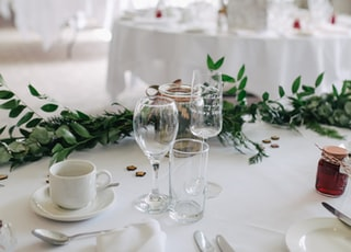 selective focus photography of clear wine glasses on table