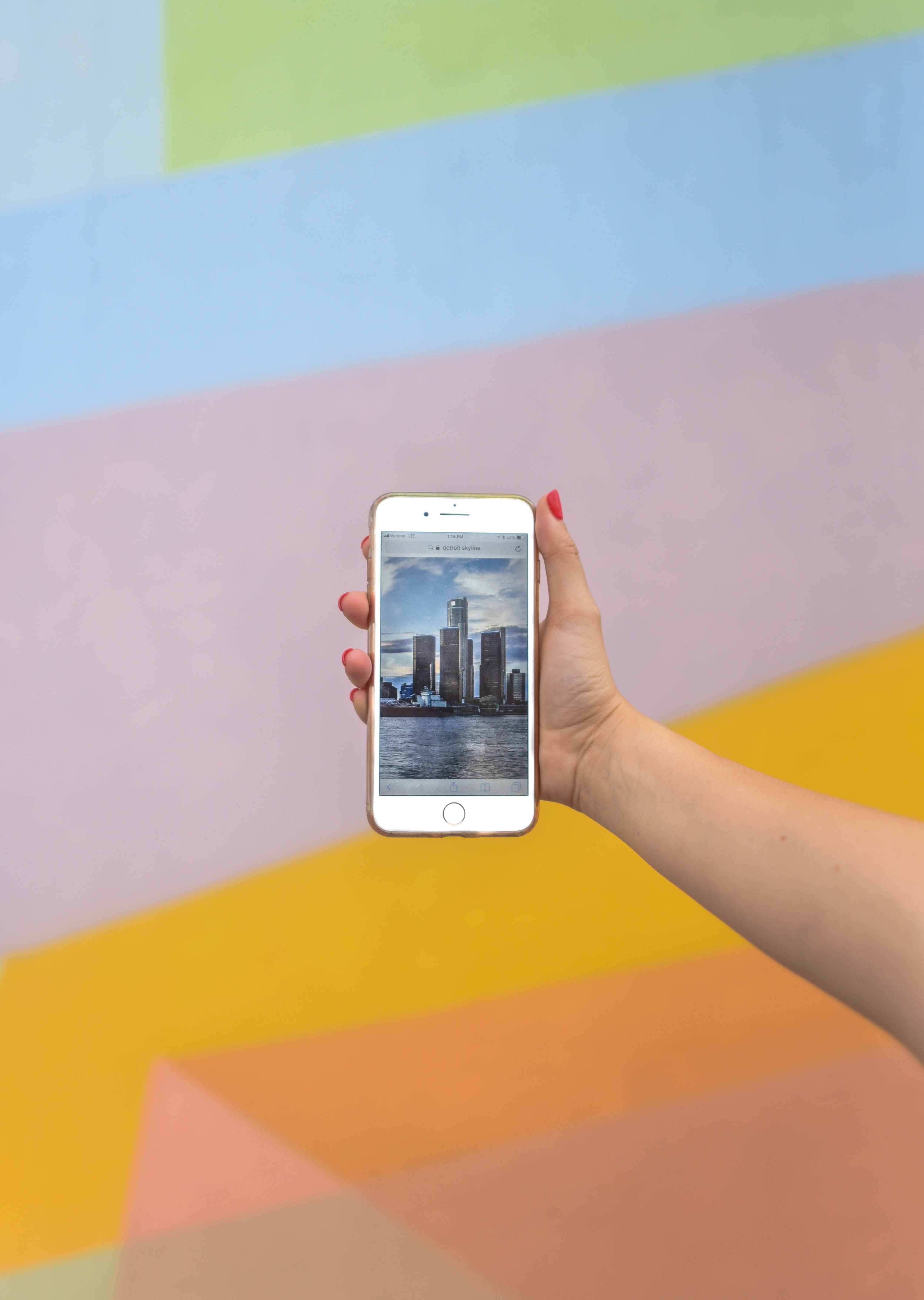 Person Showing High Rise Buildings Using Iphone