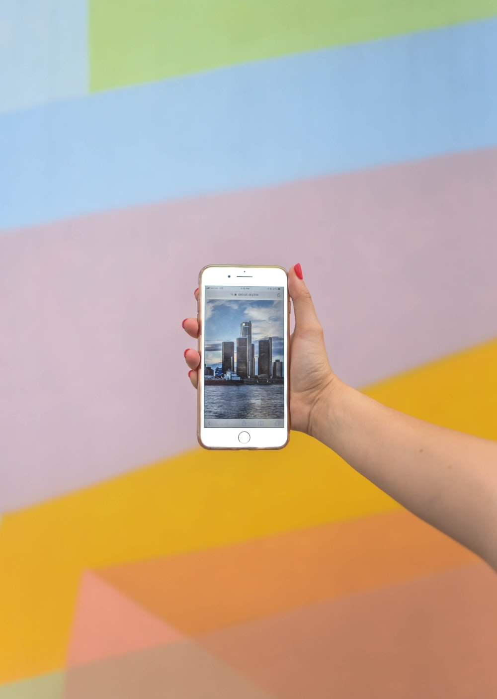 person showing high-rise buildings using iPhone