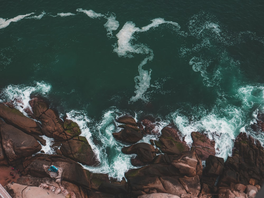 tidal waves into rock