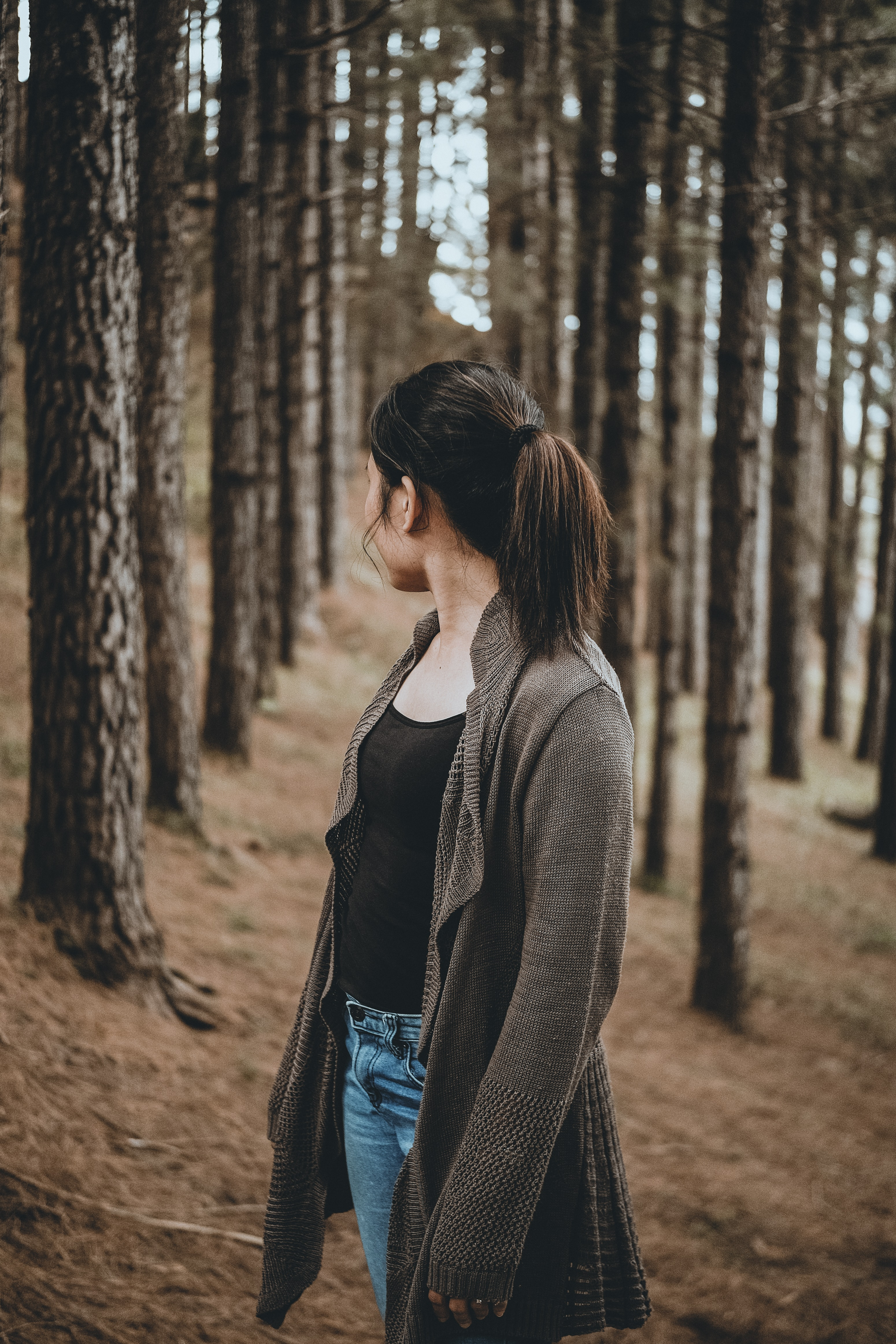 selective focus photography of woman looking back