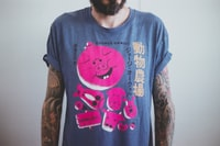 man wearing blue and pink angry bird-printed t-shirt