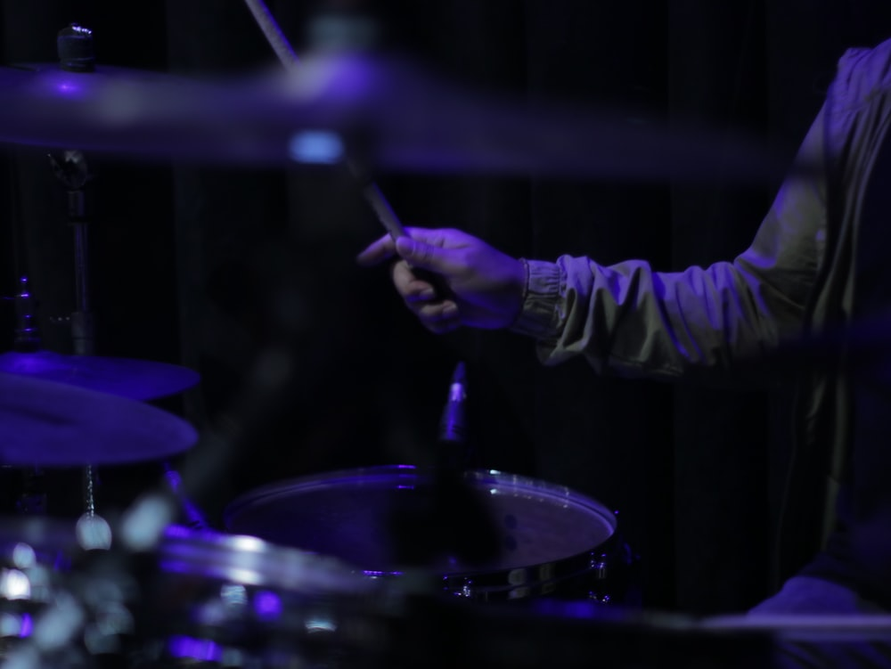 person holding drum stick