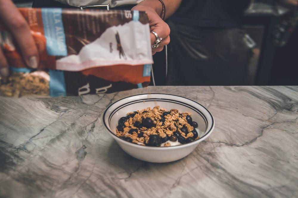 flux seed oatmeal on white ceramic bowl