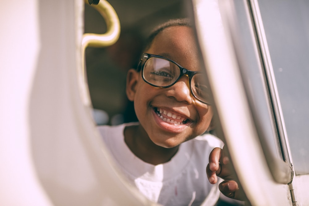 boy taking picture on window