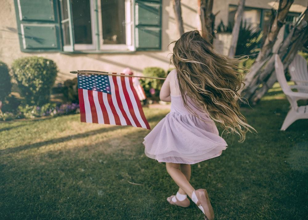 girl holding flag of USA