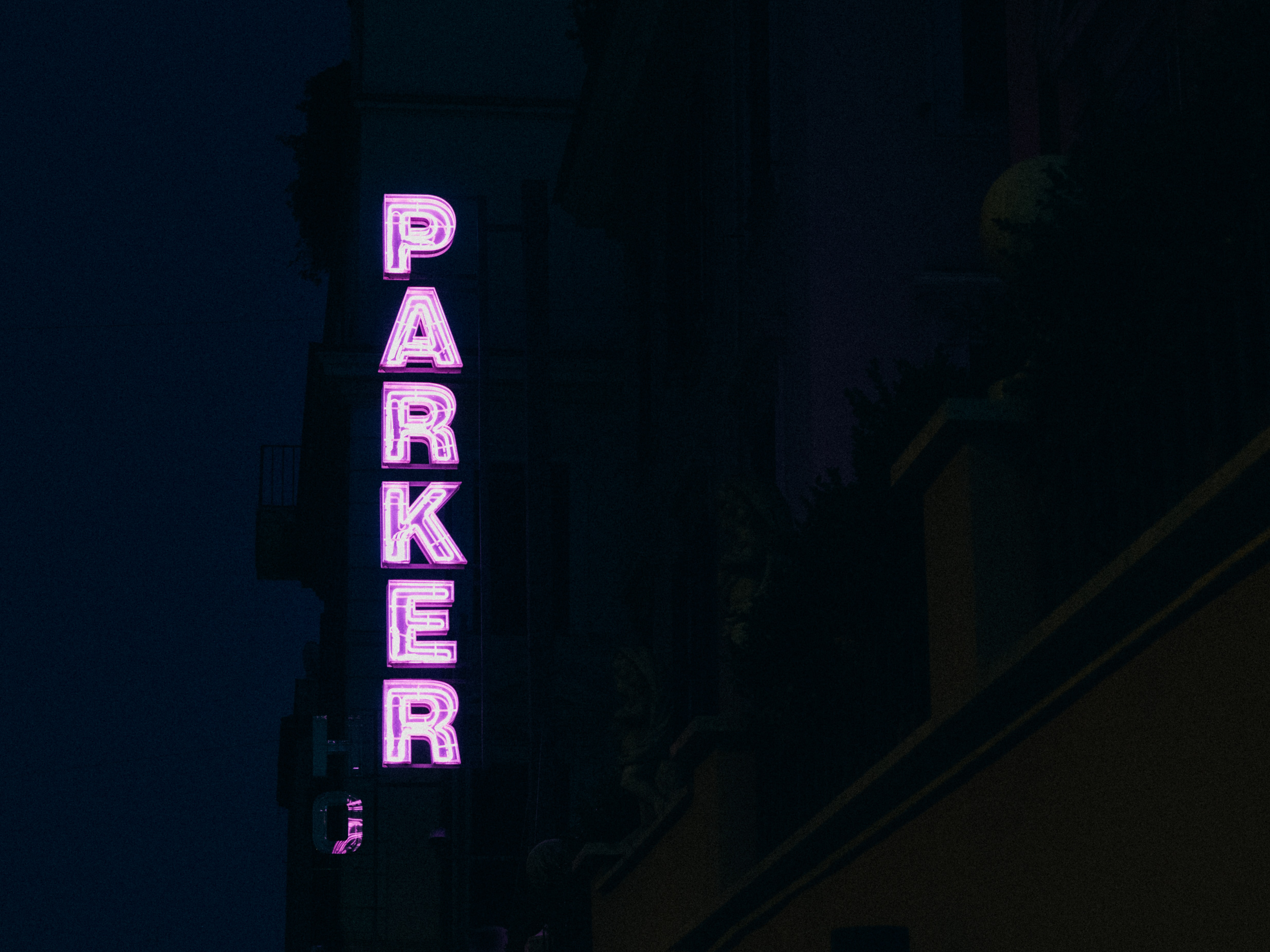 lit Parker neon light signage on a side of a building