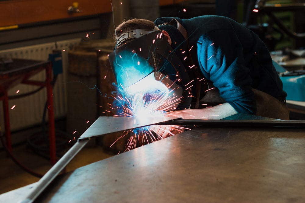 man welding iron