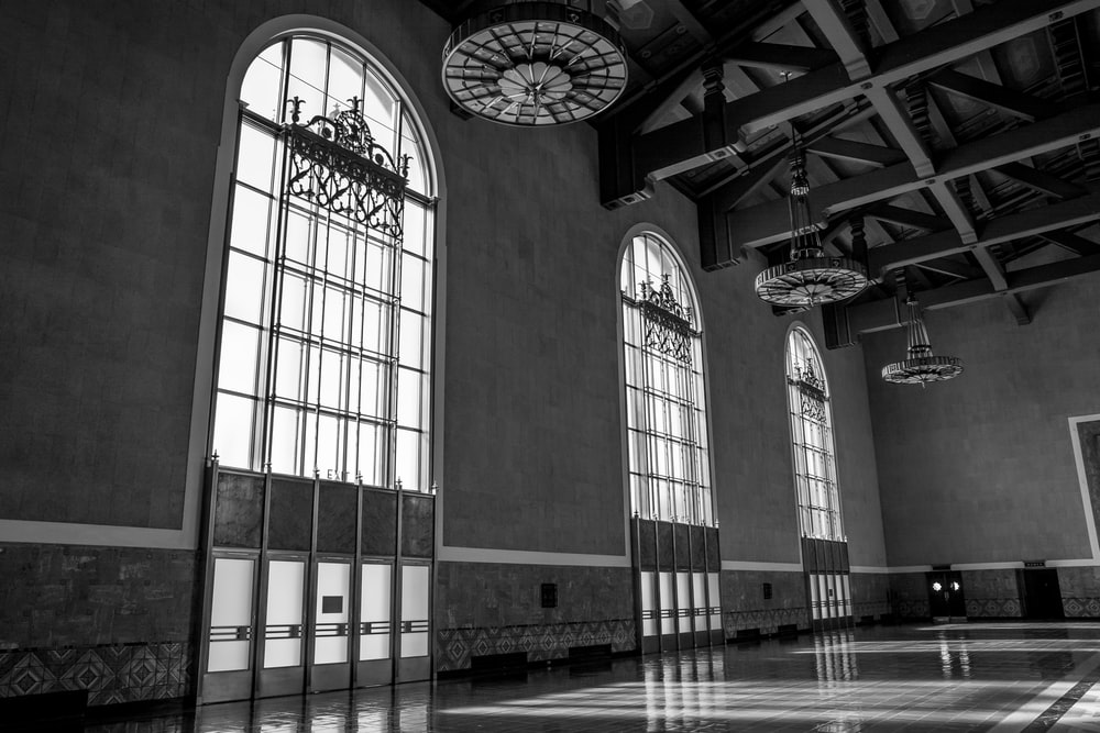 hallway with three large arch-shaped windows