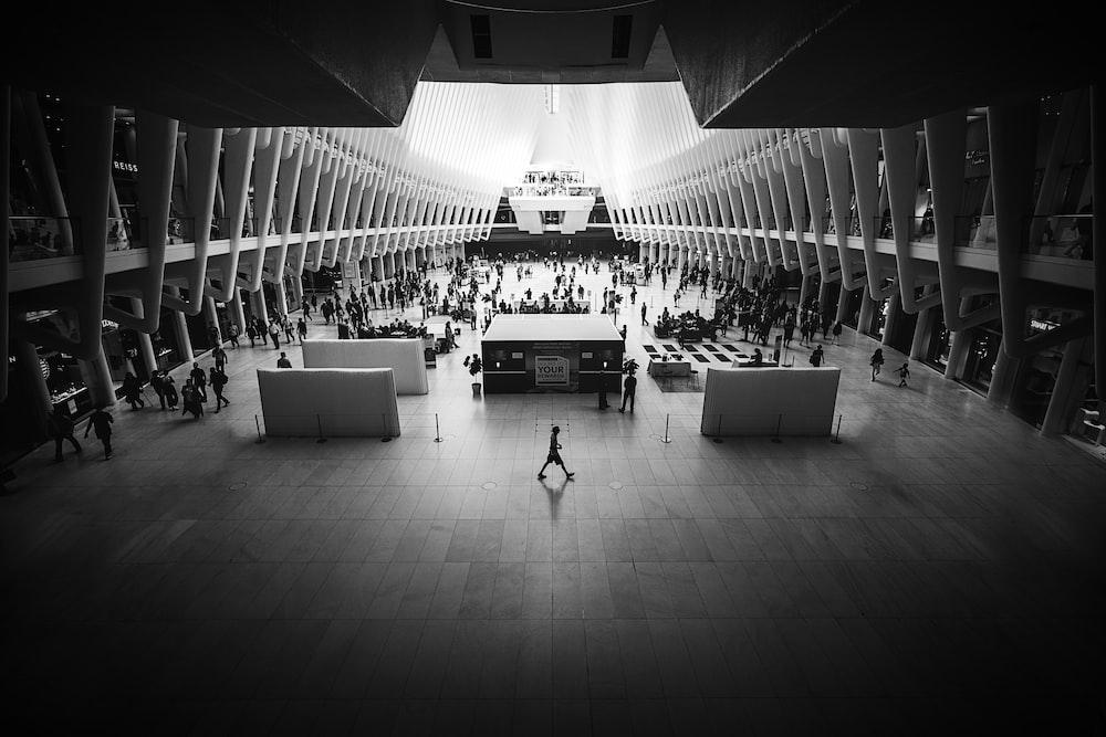 grayscale photo of people indoor