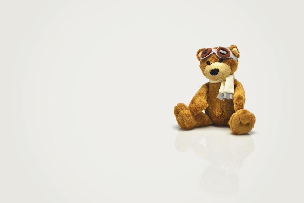 brown bear plush toy on white surface